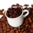 Cup with coffee beans - Foto de Stock