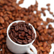 Cup with coffee beans — Stok fotoğraf