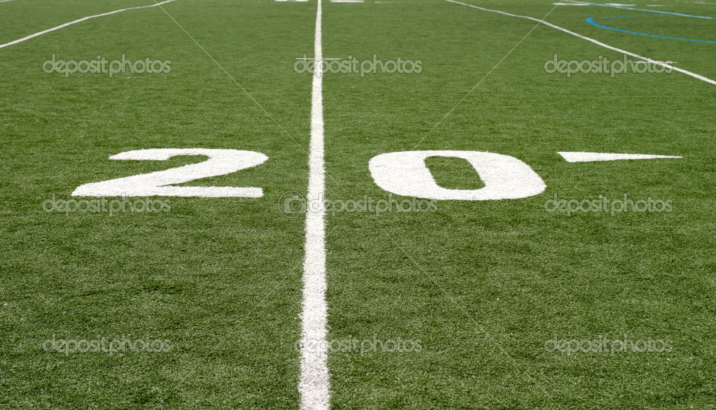 Green football field with large yard numbers. — Stock Photo #1632374