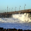 Ocean Wave Storm Pier - Stock Photo
