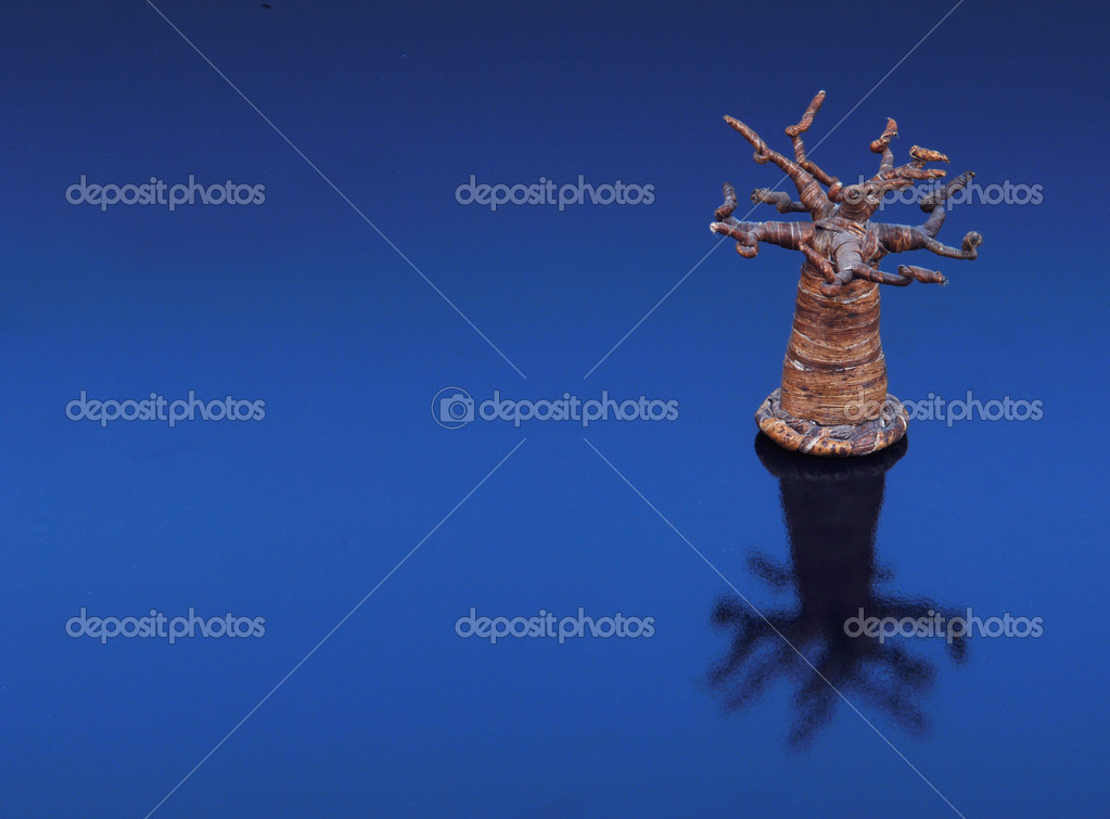Tree on blue background — Stock Photo #1326473
