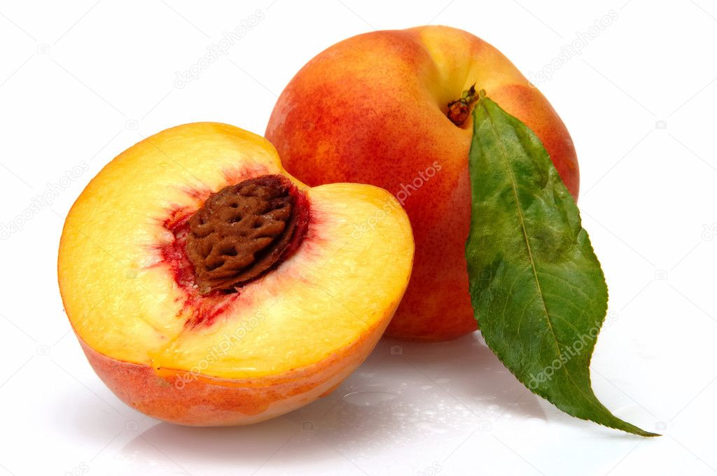 Peach and half of piece with bean — Stock Photo #1532183