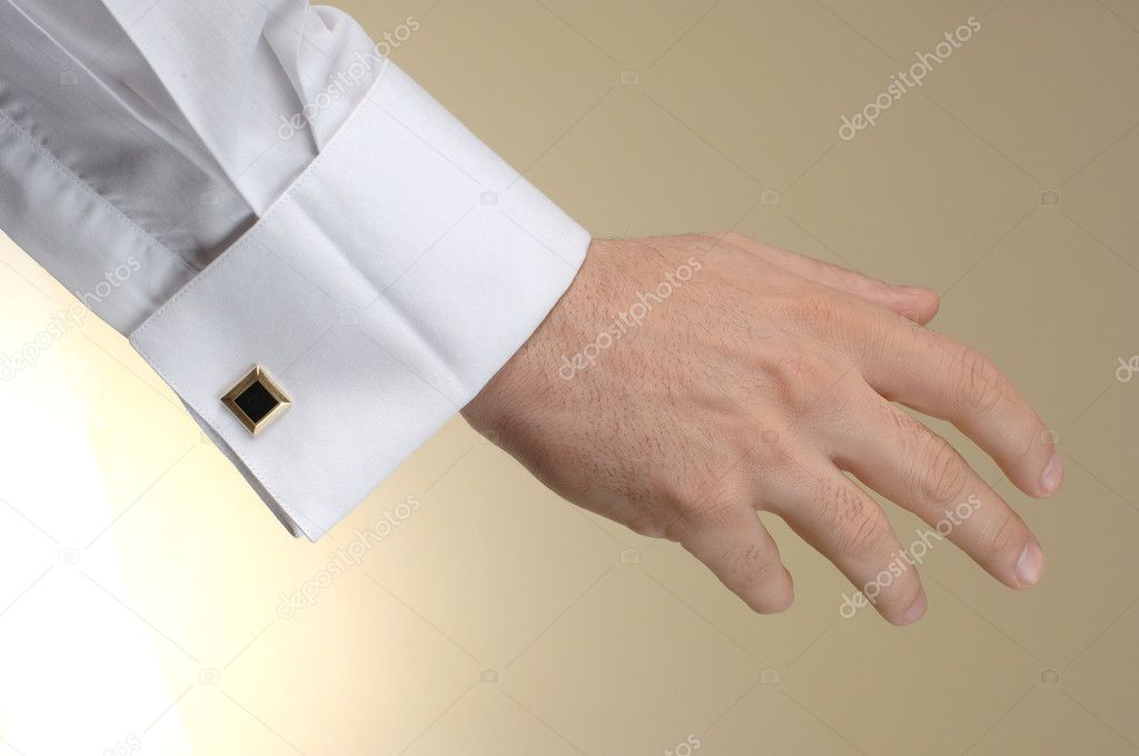 Man hand show someting at the beige background — Stock Photo #1596528