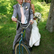 Newlyweds on a bicycle. — Stock Photo