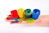 Smeared with paint child's hand — Stock Photo