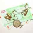 Old coin, bullets, banknote and card — Stock Photo