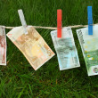 Euro banknotes on a washing line — Stock Photo