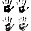Four black and white palm prints — Stock Photo