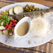 Grilled trout with rice and vegetables — Stock Photo