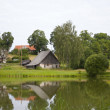 Riverside view of a village - Stock Photo