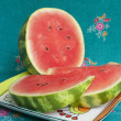 Sliced watermelon on blue background — Stock Photo