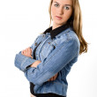 The beautiful girl in a jeans jacket — Stock Photo