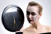 Beautiful woman holding big clock — Stock Photo
