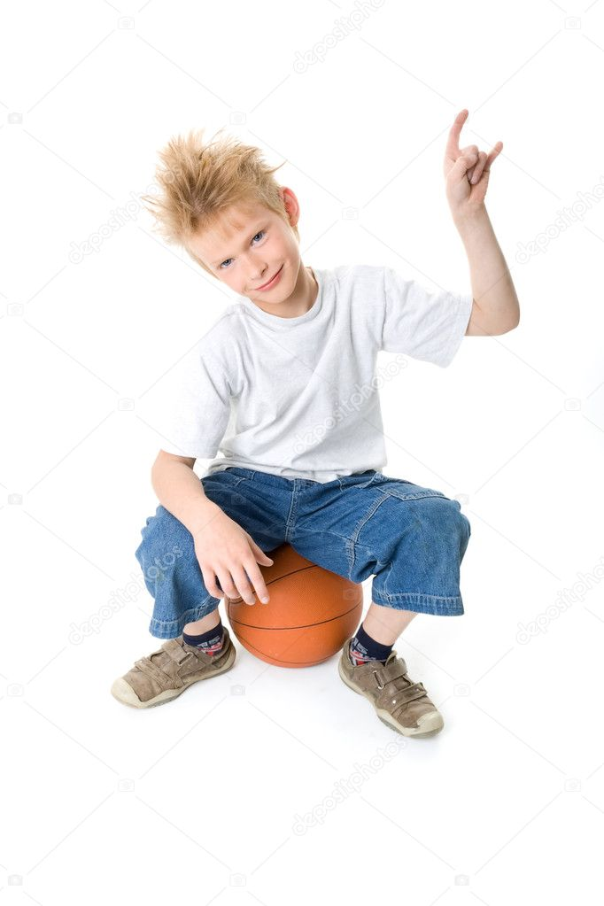 The boy with a basketball ball isolated on a white background — Stock Photo #1311829
