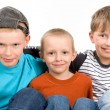 Three boys on a white — Stock Photo