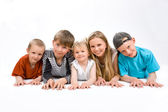 The group of five children on the foor — Stock Photo