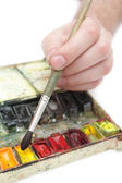 Man's hand with paintbrush — Stock Photo