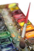 Well-used brush and paintbox — Stock Photo