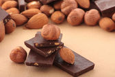 Almond nuts and pieses of milk chocolate — Stock Photo