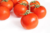 Full-ripe tomatoes isolated on white — Stock Photo