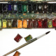 Well-used paintbox and brushes - Stock Photo