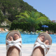 Feet with near pool — Stock Photo #1382564
