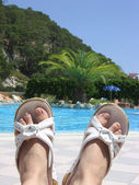 Feet with near the pool — Stock Photo