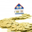 Golden coins and house — Stock Photo