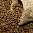 Linen bag with fragrant coffee on beans — Stockfoto