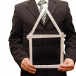 Man holding a symbol of house — Stock Photo