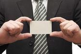 Businessman handing business card — Stock Photo