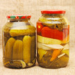 Jars with tinned vegetables on sacking — Stock Photo #1382788