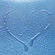 Royalty-Free Stock Photo: Heart between water drops