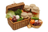 Fresh,tinned vegetables in a wattled box — Stock Photo