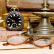 Old hours and various old things — Stock Photo