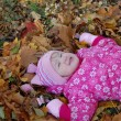 Little girl walks in autumn park — Stock Photo #1409029