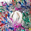 Christmas tinsel with a white toy — Stock Photo