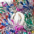 Foto Stock: Christmas tinsel with white toy