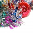 Foto Stock: Christmas tinsel with red toy