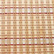 Closeup of bamboo mat background — Stockfoto #1409760