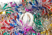 Christmas tinsel with a white toy — Foto Stock