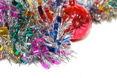 Christmas tinsel with a red toy — Foto Stock