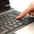 Finger typing on a laptop — Stock Photo