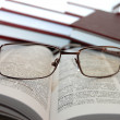 Eyeglasses on books — Stok fotoğraf