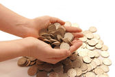 The female hand takes coins — Stock Photo