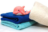 The combined colour towels with a toy — Stock Photo