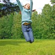 Jumping happy girl - Stock Photo