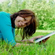 Woman lays on green field — Stock Photo