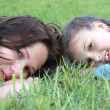 Mother resting outdoor with daughter — Stock fotografie