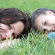Mother resting outdoor with daughter — Stock Photo